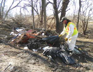 new-Homeless camp worker.tif