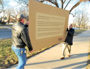 Museum Sign-carrying down sidewalk.tif