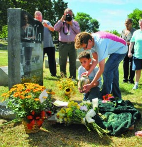 Laid to rest. Eight-year-old Atticus and his mother Jamie Straley carry Ella's ashes to her gravestone. The Straley's visited Ella on a regular basis when she was alive. Leslie Collins
