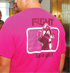 Fight like a girl. The city of Kansas City isn't taking breast cancer lightly. This year, the Kansas City Fire Department designed breast cancer awareness T-shirts and will donate the proceeds to the Breast Cancer Research Foundation. Above, a firefighter shows off the custom designed T-shirt. Leslie Collins