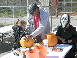 FRONT PAGE__VFW pumpkin carving-grp of 3.tif