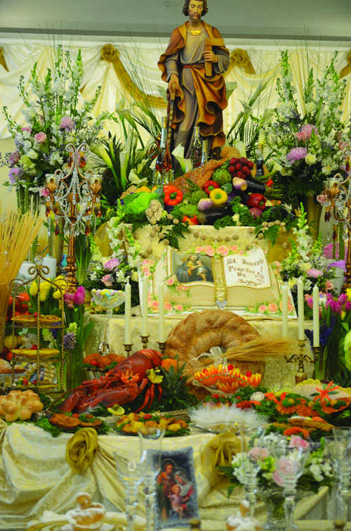 The St. Joseph table at Holy Rosary is decorated with cookies and other food, as well as flowers.