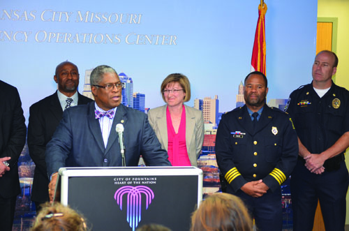 Mayor Sly James, speaking at the podium, was joined by Jackson County prosecutor  Jean Peters Baker and police chief Darryl Forté, at Friday's press conference.