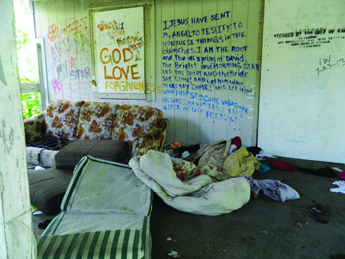 Homeless camps were found in the Lykins Neighborhood Wednesday Morning. Michael Bushnell.