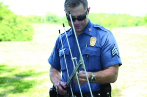 Sgt. James Gottstein of the KCPD demonstrates how to use the new care trak system. Submitted photo.