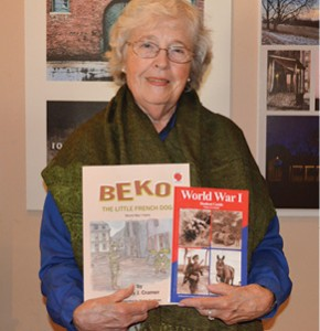 Author. Nancy Cramer poses with her two books, Beko and World War I: Student Guide. Joe Jarosz