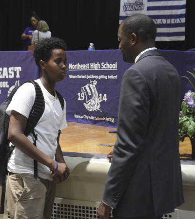 KCPS Superintendent Dr. Mark Bedell speaks with a student after his speech at Northeast on Tuesday, August 30.