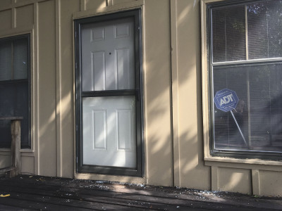 The back door of the Northeast News, which was hit by a stray bullet on the night of Wednesday, August 24.