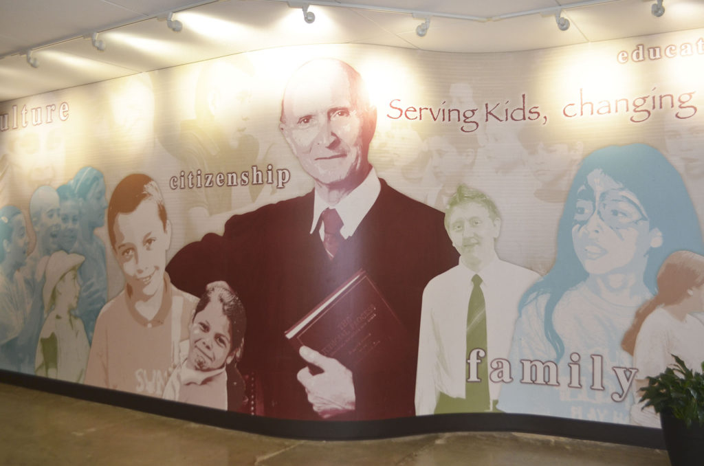 A mural of Judge Charles Shangler is prominently featured in the cafeteria of Scuola Vita Nuova.