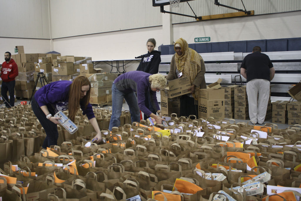 Every year at Thanksgiving, Della Lamb fills its gym with Thanksgiving fixings for low-income families.