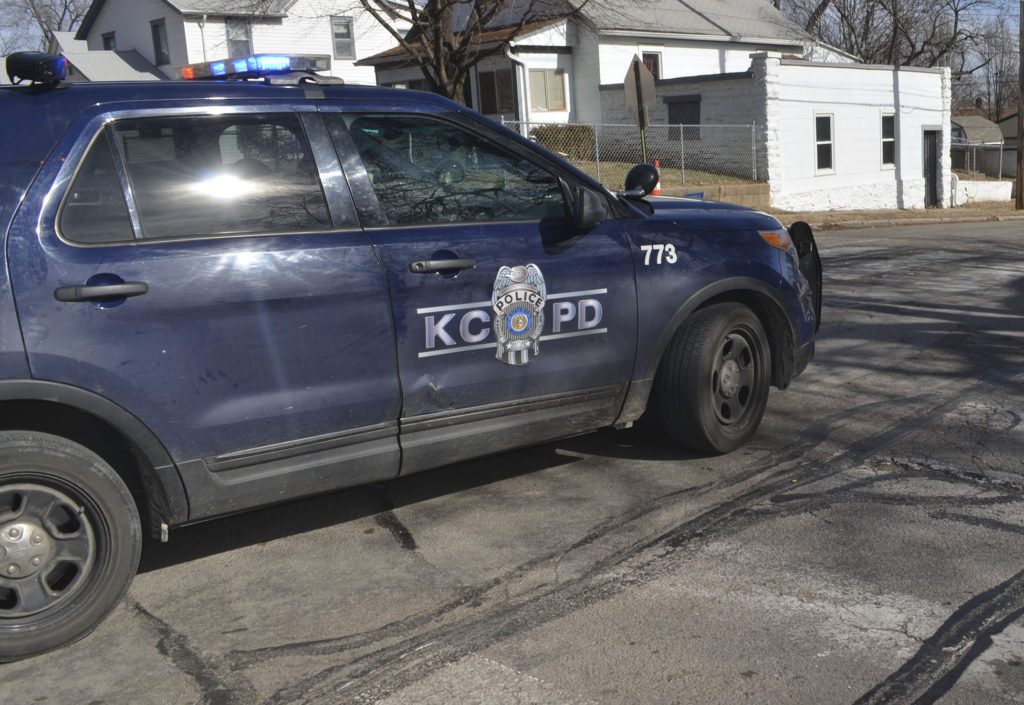 A KCPD vehicle parks in the middle of the intersection of N. Bellaire and Scarritt in the Historic Northeast. Several bullet casings were found in the intersection, which is across the street from James Elementary School.